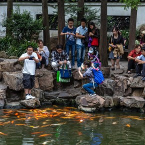 Familis feed Kois in Yu Yuan garden